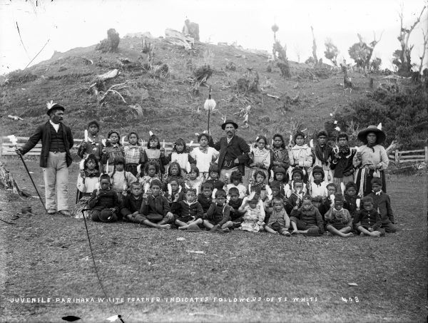 Affectionately known as tātarakihi, the singing cicadas, children played a lead role in the Parihaka's response to invasion. They played skipping games at the entrance to the pā and sang waiata as the soldiers approached. The children in this group portrait hold the raukura, the white albatross feather, a symbol of peace and the timeless emblem of Parihaka, New Zealand's birthplace of nonviolent resistance.