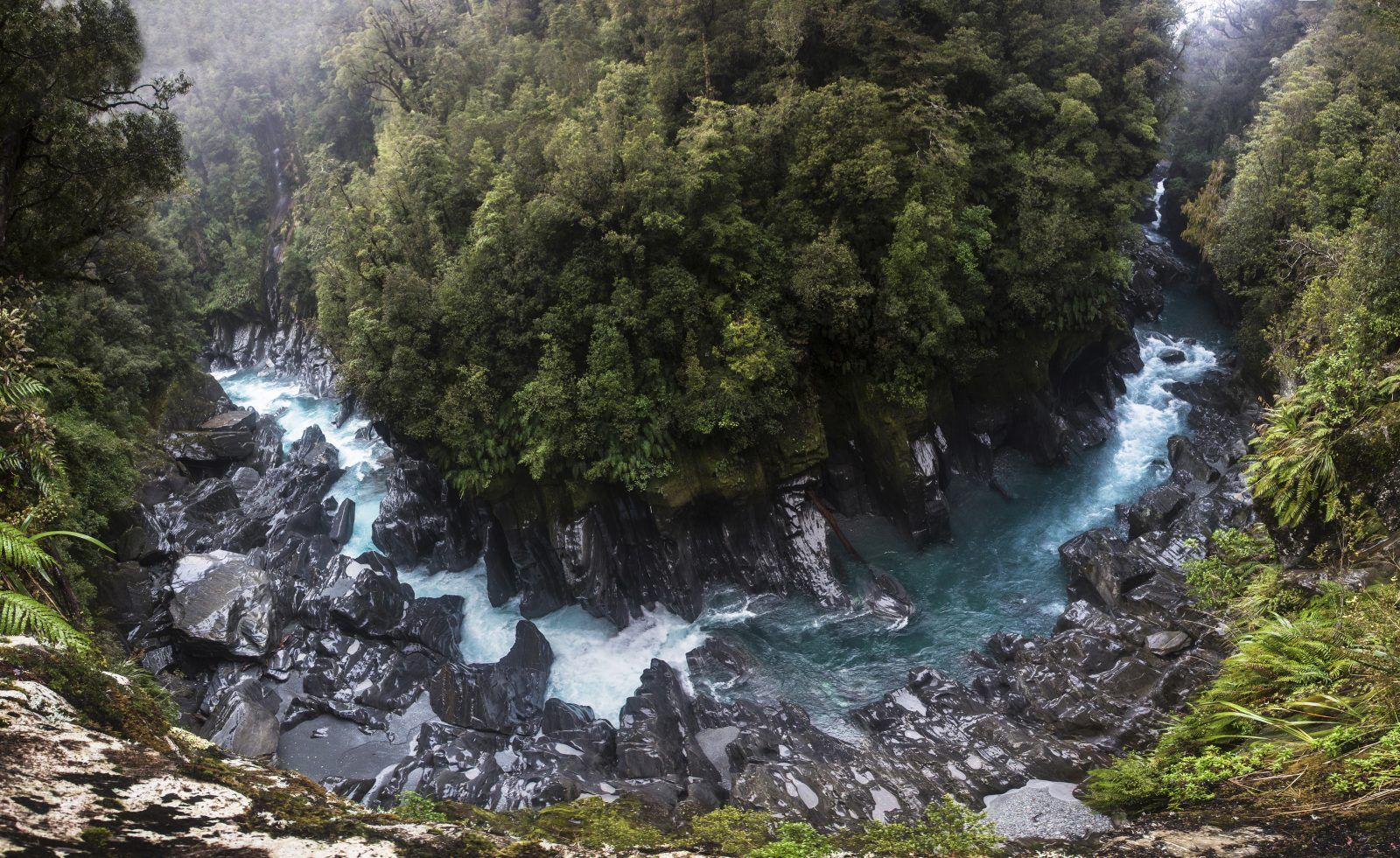 "Aeons of polishing by water and fine glacial sediment give a glossy sheen to the schist ramparts of Morgan Gorge, at a point where the Anson Stream tributary meets the Waitaha River. The river has its origins in Ivory Lake, near the Main Divide, at an altitude of nearly 1400 metres, and meets the coast between Harihari and Ross. The gorge and the upper Waitaha has been described by landscape consultants reporting on the proposed scheme as an ""eminent"" and ""outstanding"" natural landscape."