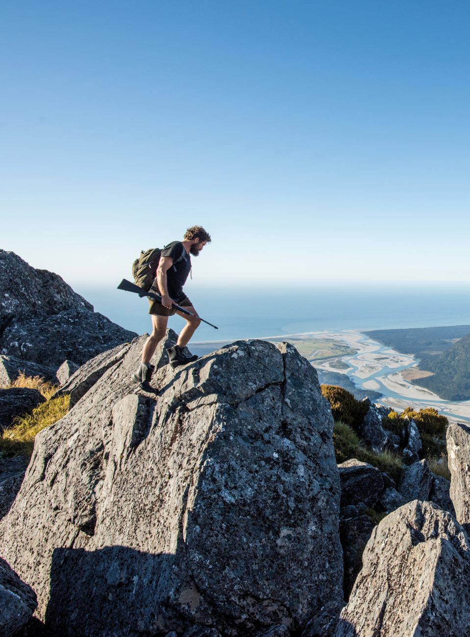 Mountains, forest and sea: Josh James walks high above the Haast River as it flows into the Tasman Sea in braids. The sandflies remain far below; these ranges are home only to mountain lakes and sure-footed chamois.