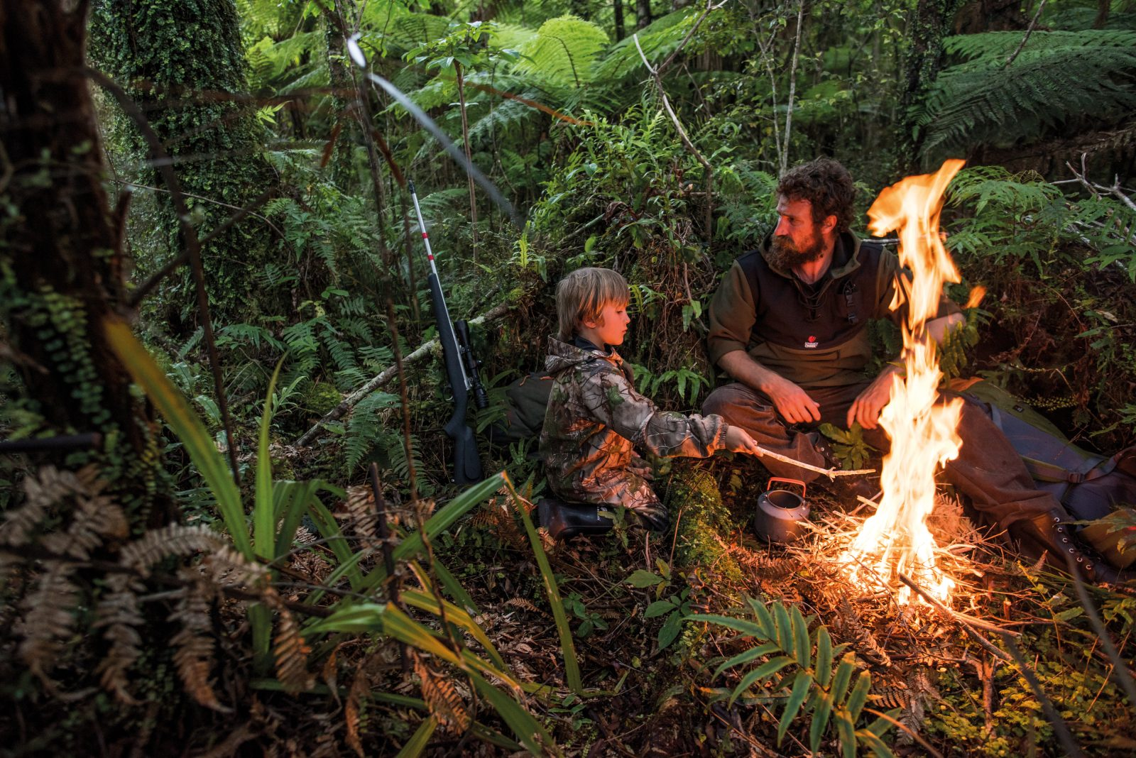"""Another night in the woods of Haast for the James boys, and another opportunity to school his son in the demanding curriculum provided by wild places. """"I think it's good for everyone to sleep alone in the bush,"""" says James. """"Not in a tent, with the security of the walls, but under the stars. It's scary, we've all got our demons and our dark spots, but it's good for you."""""""